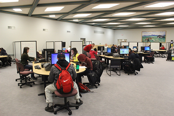 Lethbridge College student finishing up assignments and using time management techniques taught at The Learning Cafe around the Library on Dec.1.