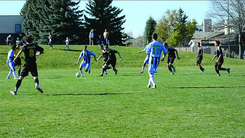 Number 7, Nico Pasquotti, makes his move towards the goal on Oct. 17, when the Lethbridge College Kodiaks defeated the Olds College Broncos 11-0.