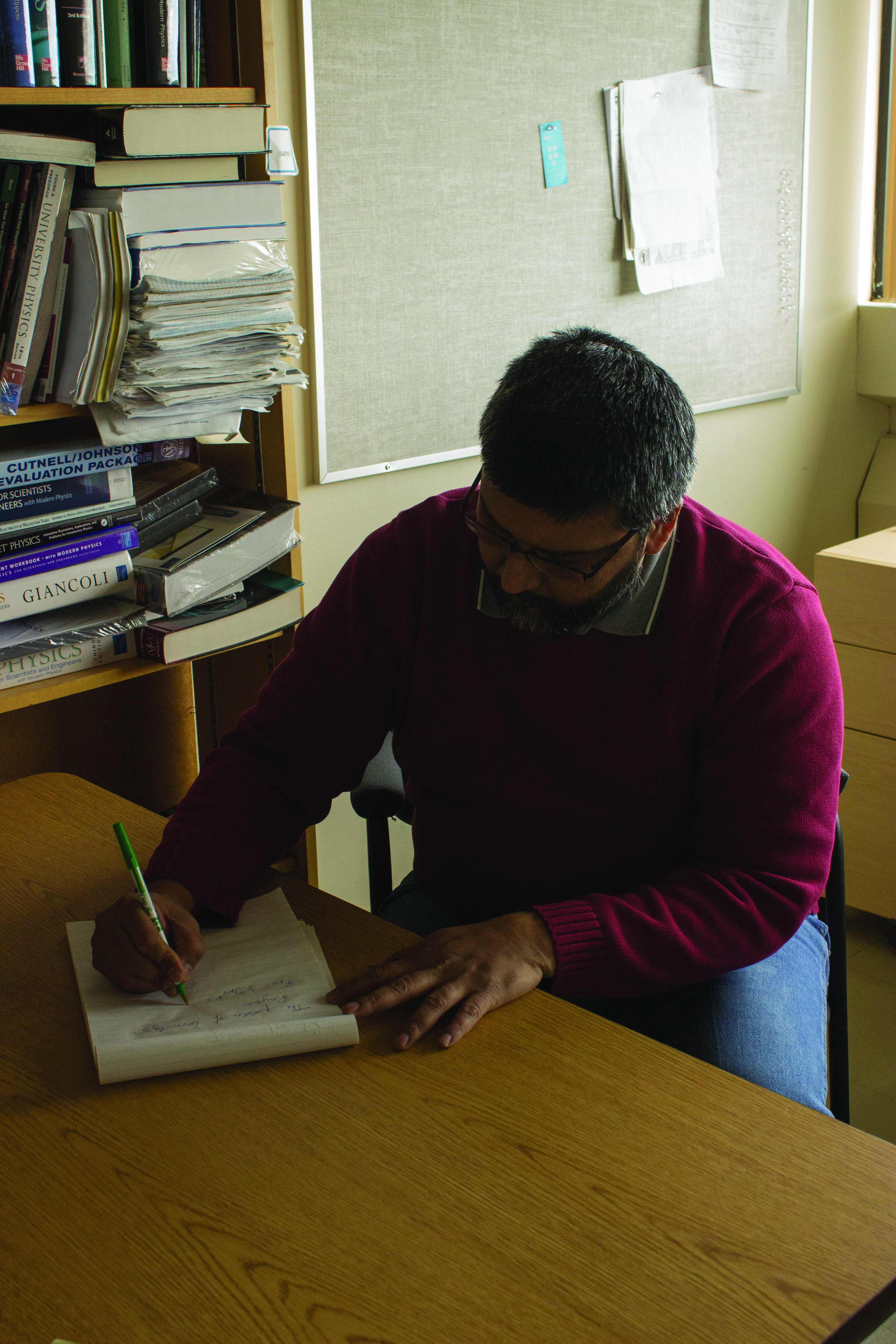 Saurya Das works on equations in his office at the University of Lethbridge.