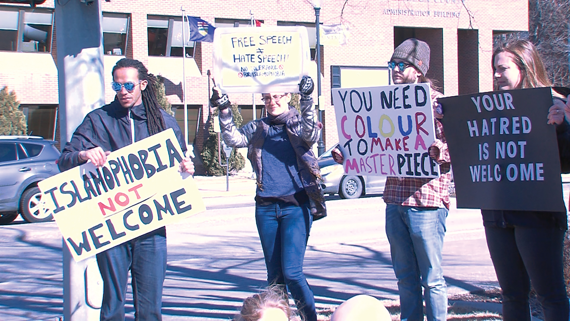 Nicholas Rickards (Islamophobia not welcome sign) with other diversity supporters at a rally at City Hall on March 4.