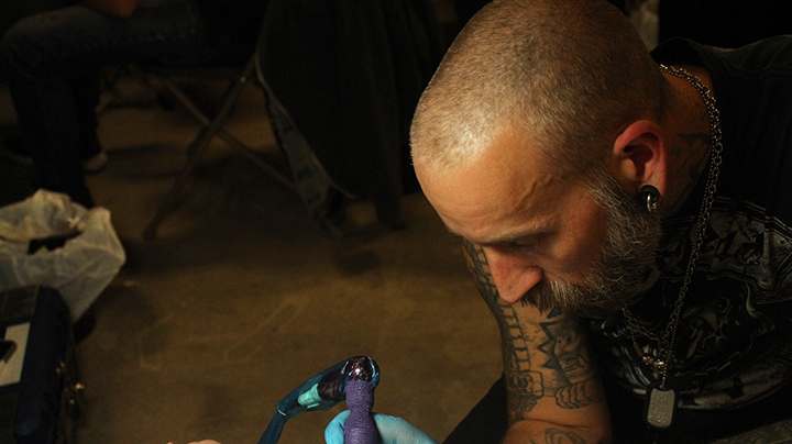 Manny Landry from Harbourside Tattoo in Vancouver, BC tattoos an arm at the Windy City Tattoo Convention in Lethbridge on September 16.
