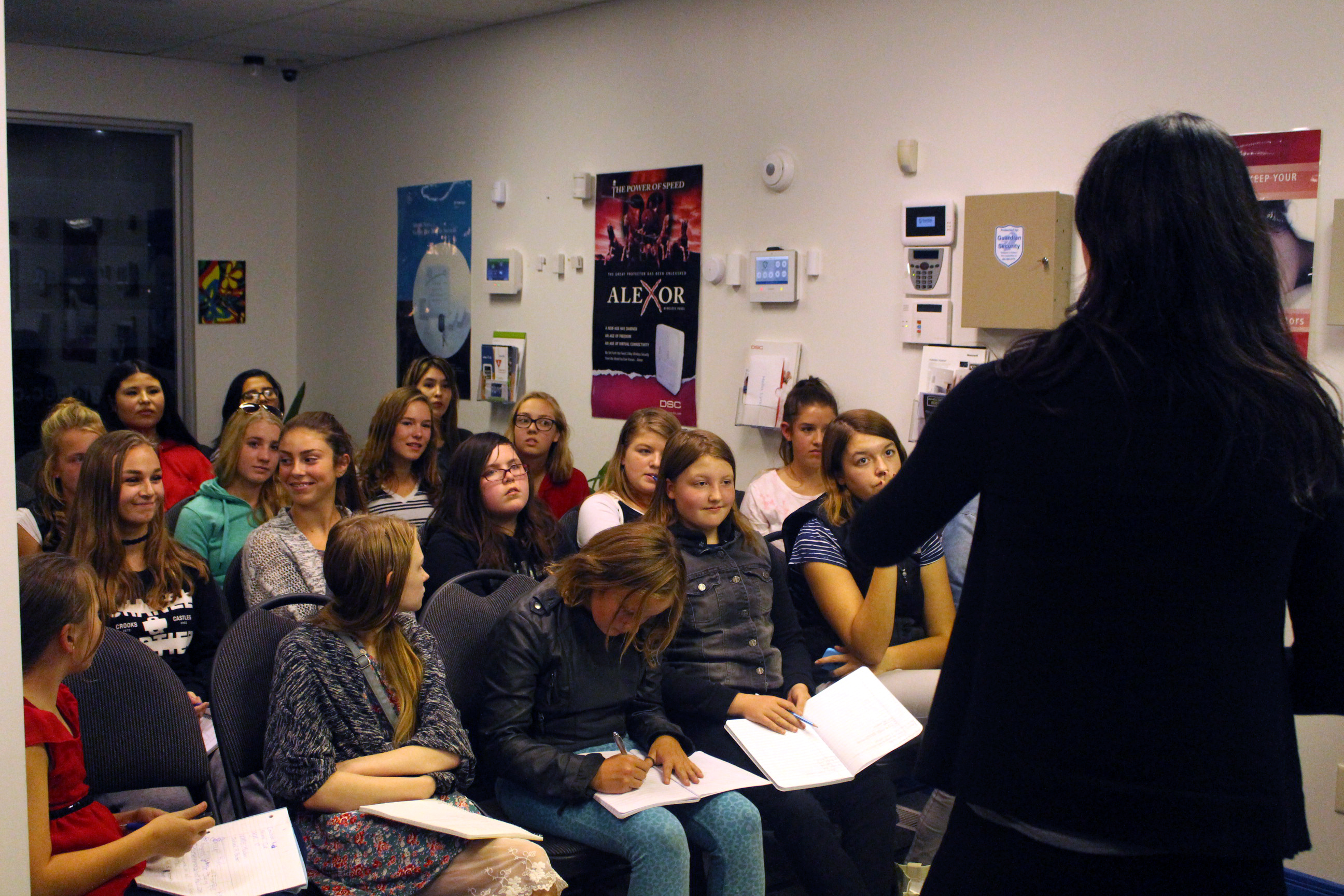 Renae Peterson instructs her Beauty from the Inside Out class of girls ages 11 to 17 on the best way to present yourself at first glance - posture, on September 25, 2017 at Guardian Security Solutions in Lethbridge.