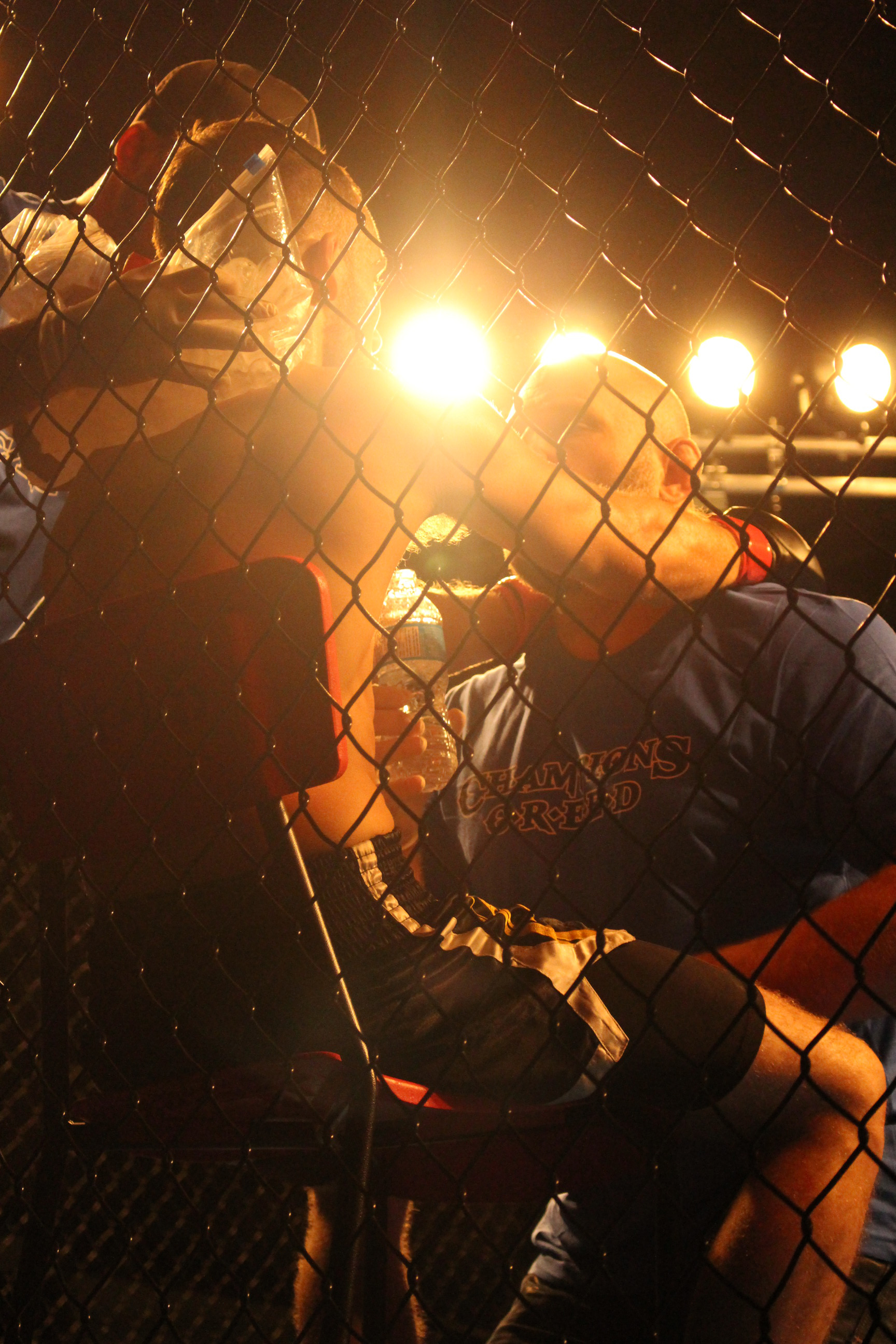 Jesse Richardson has an inbetween rounds chat with his coach Brian Bird at Rumble in The Cage at Servus Sports Centre in Lethbridge on September 30, 2017.
