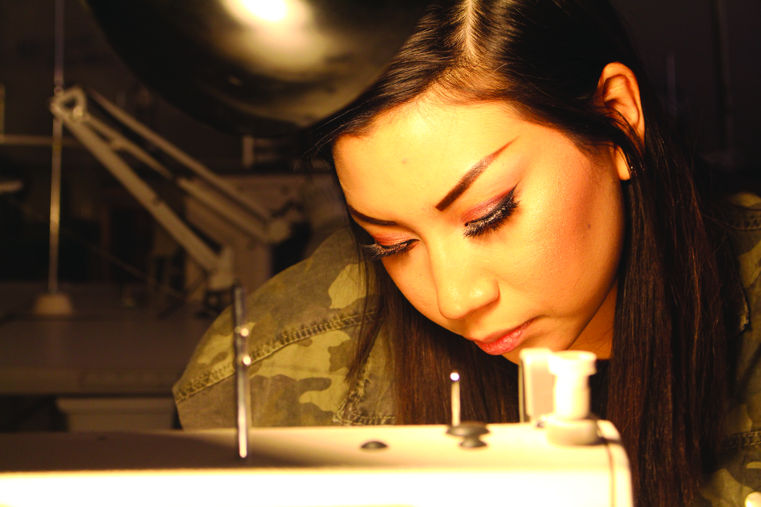 Tiara Crow Flag, works intently on surging her fabric together for an assignment in the Lethbridge College Sewing Labs on October 30, 2017.